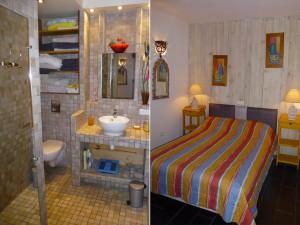 Vue de la salle de bain et de la chambre de l'appartement BLEU